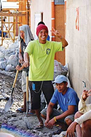 Working to rebuild after a typhoon in the Philippines.